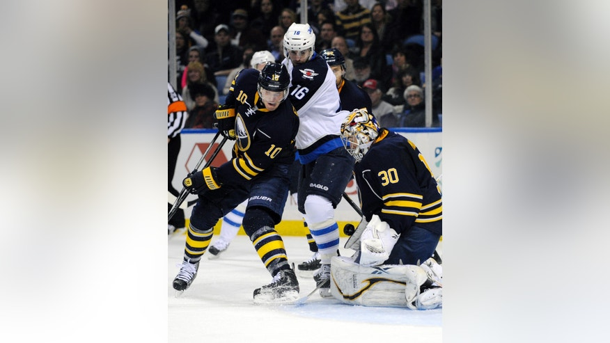 Buffalo Sabres' defenseman Christian Ehrhoff (10), of Germany, battles with Winnipeg Jets' left winger Andrew Ladd (16) as Buffalo goaltender Ryan Miller (30) makes a save during the second period of an NHL hockey game in Buffalo, N.Y., Tuesday, Feb. 19, 2013. (AP Photo/Gary Wiepert)