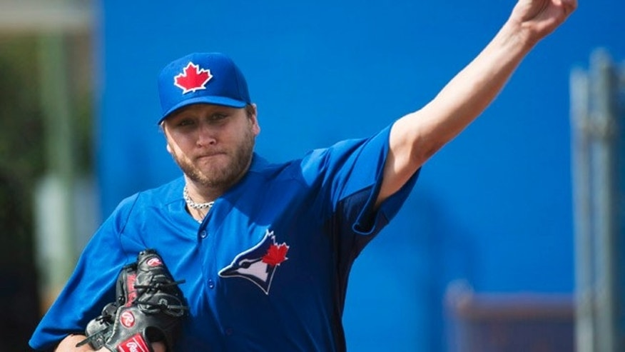 Feb. 13, 2013: Toronto Blue Jays starting pitcher Mark Buehrle throws in the bullpen during baseball spring training in Dunedin, Fla.
