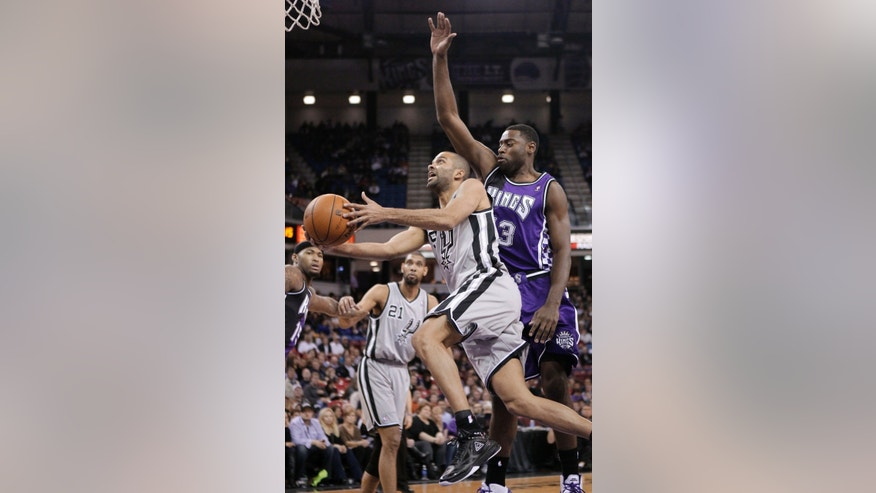 San Antonio Spurs guard Tony Parker, of  France, drives to the basket past  Sacramento Kings guard Tyreke Evans, right, during the first quarter of an NBA basketball game in Sacramento, Calif., Tuesday, Feb. 19, 2013. (AP Photo/Rich Pedroncelli)