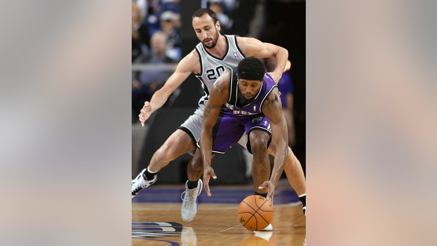 Sacramento Kings forward John Salmons, right, picks up the ball in front of San Antonio Spurs guard Manu Ginobili, of Argentina, during the first quarter of an NBA basketball game in Sacramento, Calif., Tuesday, Feb. 19, 2013. (AP Photo/Rich Pedroncelli)