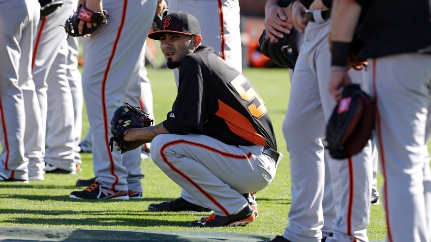 San Francisco Giants' Sergio Romo watches during a drill at spring training baseball workout Saturday, Feb. 16, 2013, in Scottsdale, Ariz.