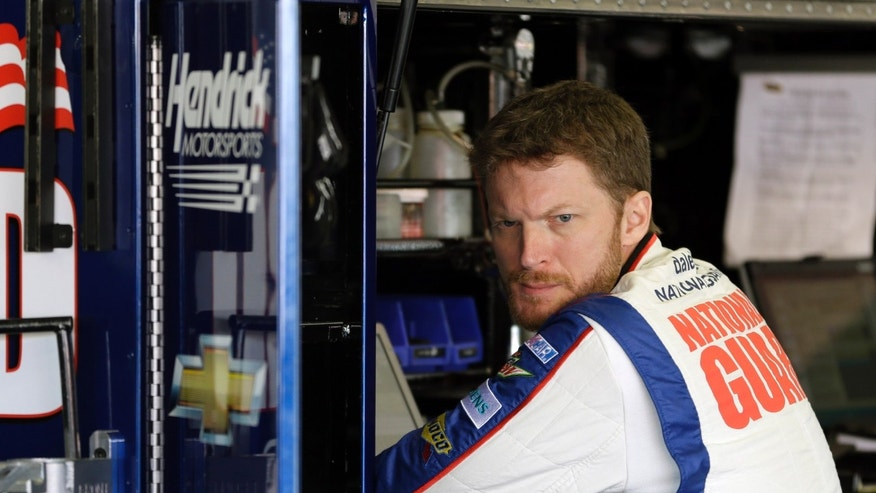 Dale Earnhardt Jr. watches as his crew gets his car ready in the garage during practice for the NASCAR Daytona 500 Sprint Cup Series auto race at Daytona International Speedway, Wednesday, Feb. 20, 2013, in Daytona Beach, Fla. (AP Photo/John Raoux)
