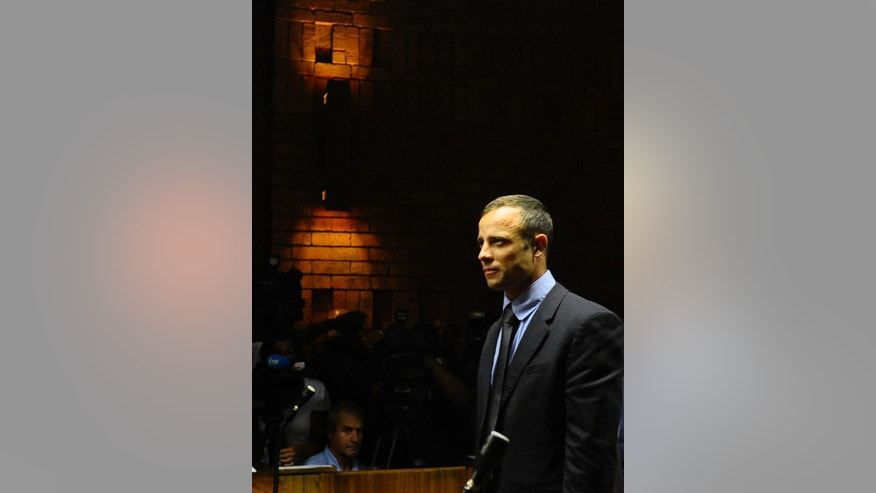 Olympic athlete Oscar Pistorius stands in court following his bail hearing in Pretoria, South Africa, Tuesday, Feb. 19, 2013.  Pistorius fired into the door of a small bathroom where his girlfriend was cowering after a shouting match on Valentine's Day, hitting her three times, a South African prosecutor said Tuesday as he accused the sports icon of premeditated murder.  The magistrate ruled that Pistorius faces the harshest bail requirements available in South African law, but did not elaborate before a break was called in the session. (AP Photo)