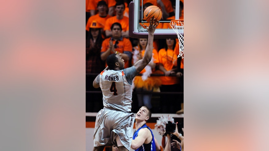 Virginia Tech's Cadarian Raines (4) shoots over Duke's Mason Plumlee during the first half of an NCAA college basketball game, Thursday, Feb. 21, 2013, in Blacksburg, Va. (AP Photo/Don Petersen)