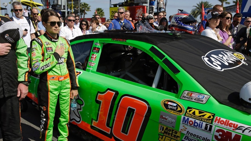 Danica Patrick stands by her car during the playing of the National Anthem before the Budweiser Duel 1 NASCAR Sprint Cup Series auto race at Daytona International Speedway, Thursday, Feb. 21, 2013, in Daytona Beach, Fla. (AP Photo/John Raoux)