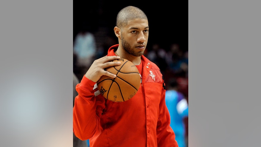 ADVANCE FOR WEEKEND EDITIONS, FEB. 23-24 - FILE - In this Oct. 12, 2012, file photo, Houston Rockets' Royce White appears before an NBA preseason basketball game against the New Orleans Hornets in Houston. White, the Rockets' first-round draft pick who has general anxiety and obsessive-compulsive disorder, may never make it in the NBA. But he may end up with a meaningful legacy anyway, as a fierce, outspoken advocate for the mentally ill and their legal rights in the workplace _ in his case, the highest level of professional basketball in the world. (AP Photo/Pat Sullivan, File)