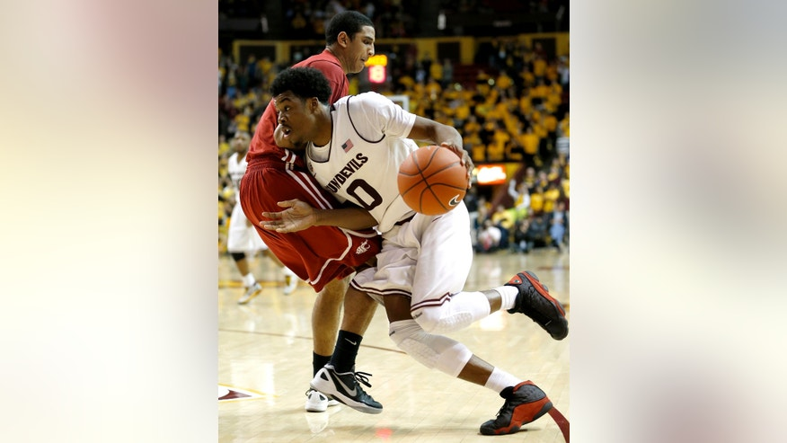 Arizona State's Carrick Felix (0) drives against Washington State's Dexter Kernich-Drew during the second half of an NCAA college basketball game, Wednesday, Feb. 20, 2013, in Tempe, Ariz. (AP Photo/Matt York)