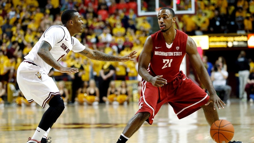 Washington State's Dominic Ballard (21) looks to pass as Arizona State's Chris Colvin defends during the first half of an NCAA college basketball game, Wednesday, Feb. 20, 2013, in Tempe, Ariz. (AP Photo/Matt York)