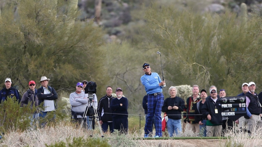 Enland's Ian Poulter watches his shot from the 16th tee in the first round during the Match Play Championship golf tournament, Thursday, Feb. 21, 2013, in Marana, Ariz. Poulter defeated Stephen Gallacher 2 and 1. (AP Photo/Julie Jacobson)