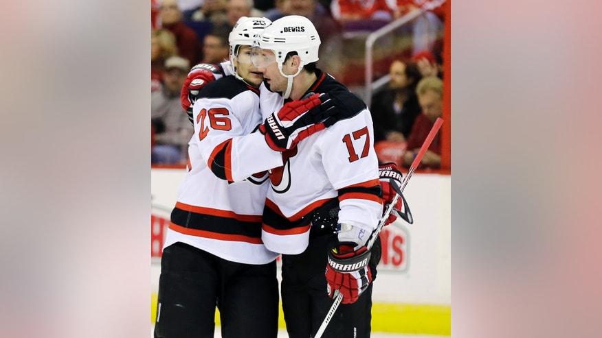 New Jersey Devils left wing Patrik Elias (26), of the Czech Republic, celebrates with right wing Ilya Kovalchuk (17), of Russia, after Kovalchuk's winning goal in the third period of an NHL hockey game against the Washington Capitals, Thursday, Feb. 21, 2013, in Washington. The Devils won 3-2. (AP Photo/Alex Brandon)