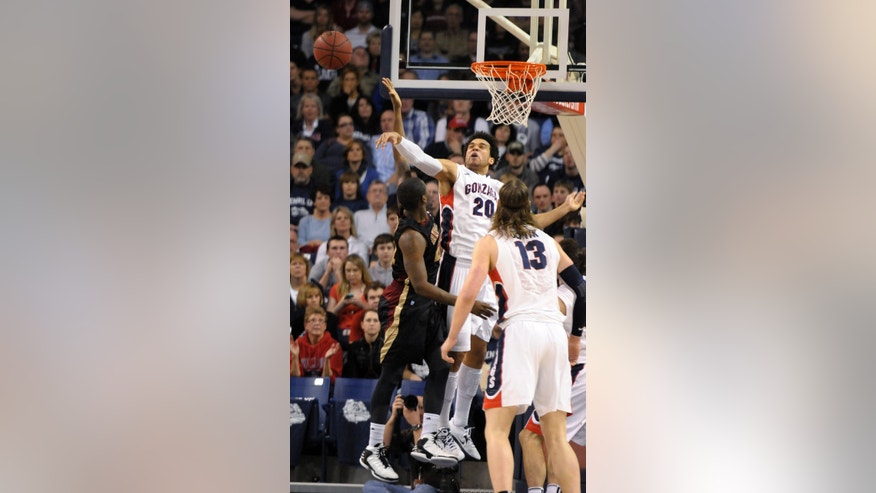 Gonzaga's Elias Harris (20) blocks Santa Clara's Kevin Foster in the first half of an NCAA college basketball game, Wednesday, Feb. 20, 2013, in Spokane, Wash. (AP Photo/Jed Conklin)