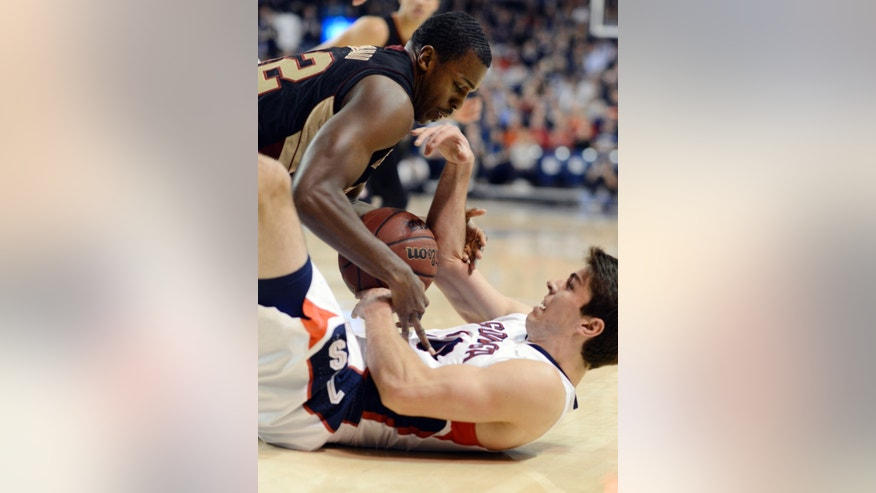 Santa Clara's Raymond Cowels III, top, tries to strip the ball from Gonzaga's Mike Hart in the first half of an NCAA college basketball game, Wednesday, Feb. 20, 2013, in Spokane, Wash. (AP Photo/Jed Conklin)