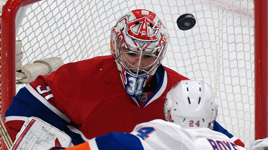 Montreal Canadiens goaltender Carey Price makes a save against New York Islanders' Brad Boyes during the second period of their NHL hockey game, Thursday, Feb. 21, 2013, in Montreal. (AP Photo/The Canadian Press, Graham Hughes)