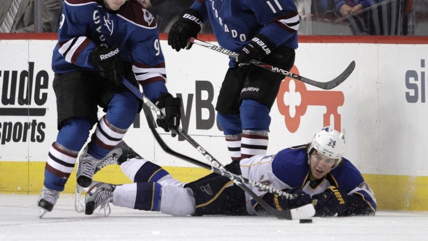 Colorado Avalanche center Matt Duchene (9) carries the puck away from St. Louis Blues right wing T.J. Oshie (74) as Avalanche left wing Jamie McGinn (11) watches during the first period of an NHL hockey game, Wednesday, Feb. 20, 2013, in Denver. (AP Photo/Joe Mahoney)