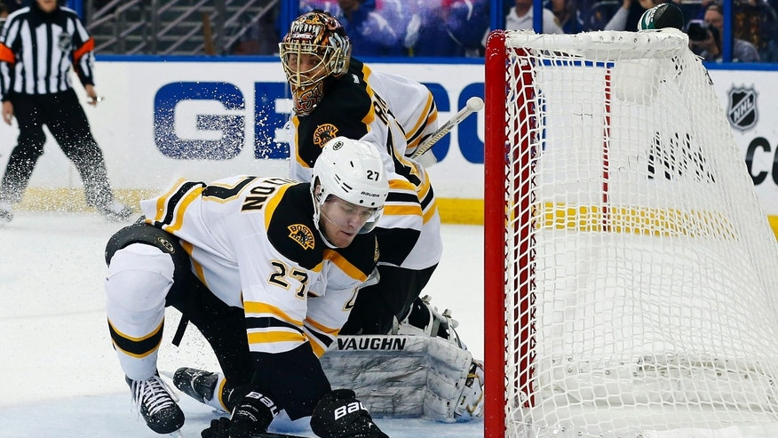 Boston Bruins' Dougie Hamilton (27) makes a save on a wrap-around attempt by Tampa Bay Lightning's Tom Pyatt, not shown, in front of Bruins goalie Tuukka Rask, of Finland, during the second period of an NHL hockey game, Thursday, Feb. 21, 2013, in Tampa, Fla. (AP Photo/Mike Carlson)