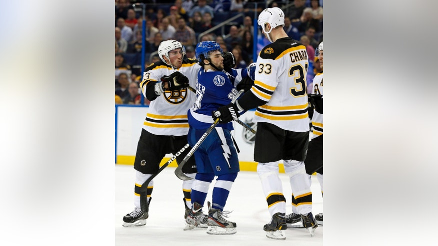 Tampa Bay Lightning's Cory Conacher, center, is confronted by Boston Bruins' Brad Marchand, left, and Zdeno Chara, of Slovakia, during the second period of an NHL hockey game, Thursday, Feb. 21, 2013, in Tampa, Fla. (AP Photo/Mike Carlson)