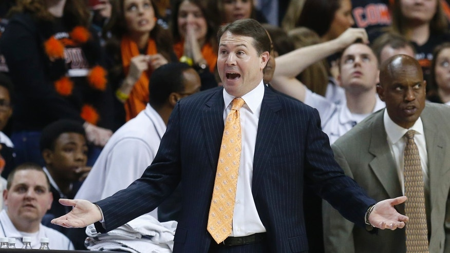 Oklahoma State head coach Travis Ford gestures in the first half of an NCAA college basketball game against Kansas in Stillwater, Okla., Wednesday, Feb. 20, 2013. Kansas won 68-67 in double overtime. (AP Photo/Sue Ogrocki)