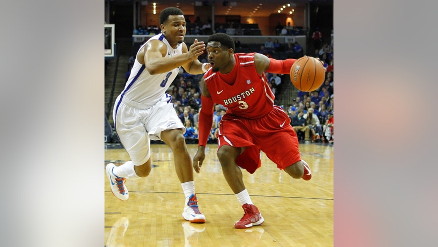 Houston guard J.J. Thompson, right, passes Memphis guard Chris Crawford (3) during the first half of an NCAA college basketball game on Wednesday, Feb. 20, 2013, in Memphis, Tenn. (AP Photo/Lance Murphey)