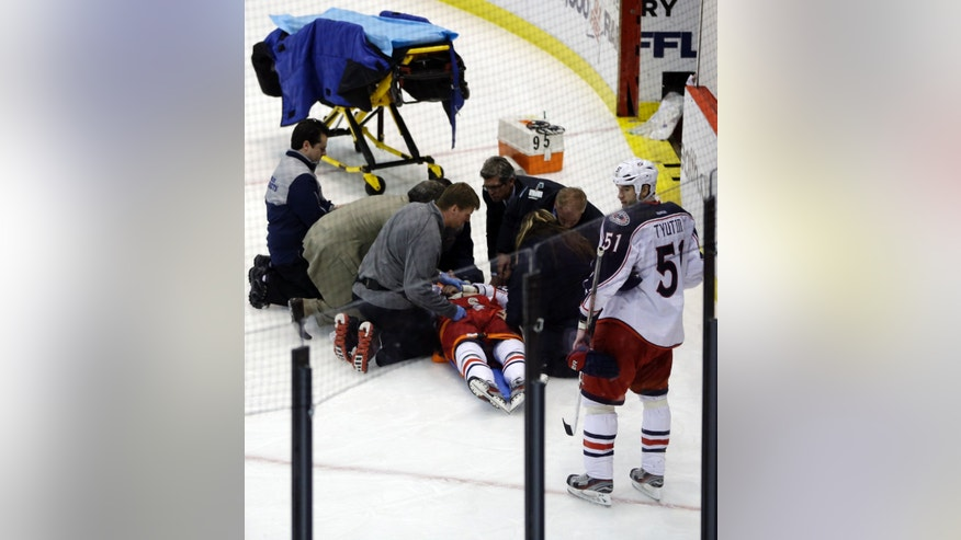 Team doctors and emergency personnel tend to Columbus Blue Jackets center Artem Anisimov, of Russia, during the second period of an NHL hockey game against the Detroit Red Wings in Detroit, Thursday, Feb. 21, 2013. (AP Photo/Carlos Osorio)