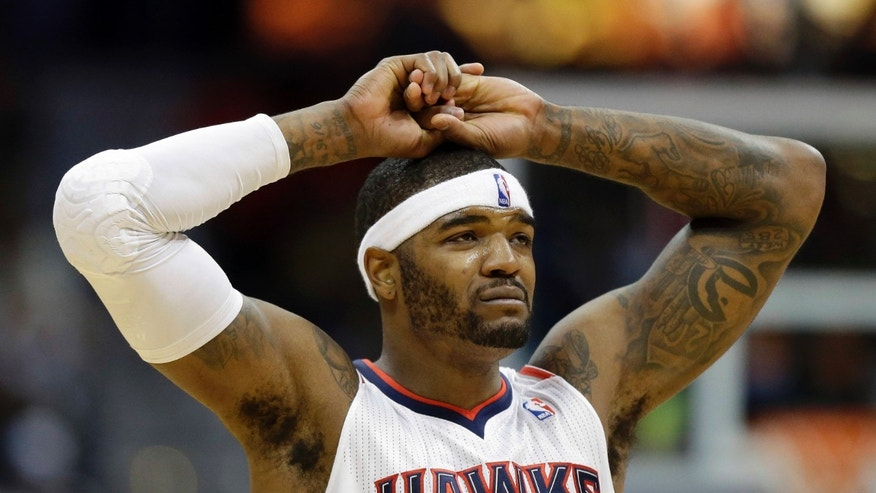 In this photo taken Feb. 20, 2013, Atlanta Hawks forward Josh Smith reacts during the second half of their 103-90 loss to the Miami Heat in an NBA basketball game in Atlanta. Smith is one of the league's most prominent names in rumors leading up to today's trade deadline. Smith said after just missing a triple-double in Wednesday night's loss that he'll be relieved when the deadline passes. (AP Photo/John Bazemore)