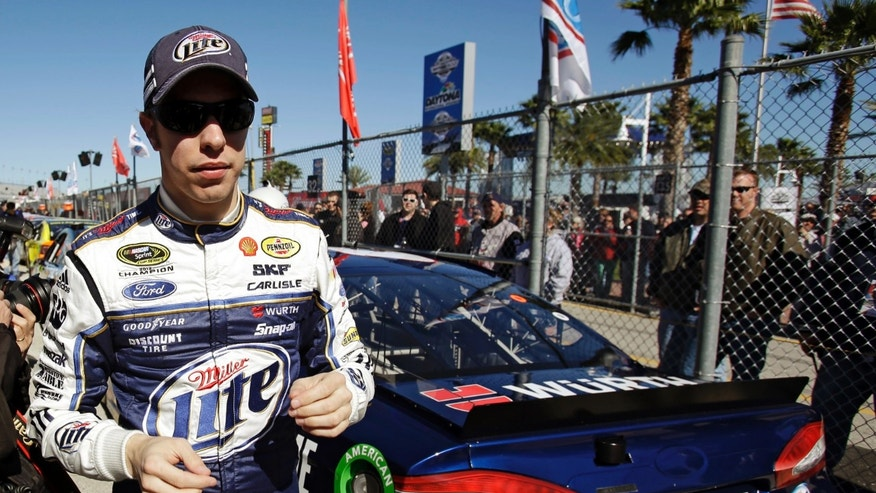 Brad Keselowski walks away from his car on pit road after qualifying for the NASCAR Daytona 500 Sprint Cup Series auto race at Daytona International Speedway, Sunday, Feb. 17, 2013, in Daytona Beach, Fla. (AP Photo/John Raoux)