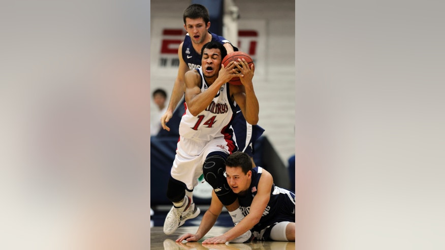 Saint Mary's Gaels guard Stephen Holt (14) tangles it up with BYU Cougars' guards Craig Cusick, top,  and Cory Calvert in the first half of the NCAA basketball game at McKeon Pavilion in Moraga, Calif., on Thursday, Feb. 21, 2013.    (AP Photo/The Contra Costa Times,Susan Tripp Pollard )