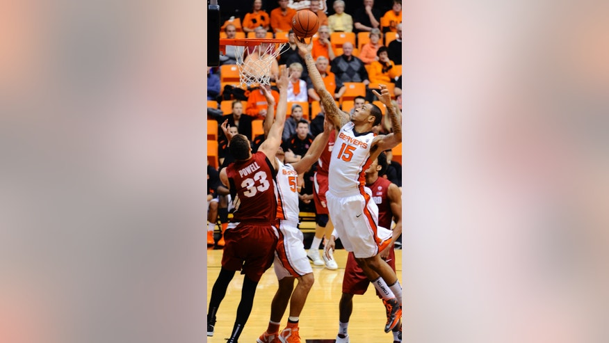 Stanford's Dwight Powell (33) shoots against Oregon State's Eric Moreland (15) during the first half of an NCAA college basketball game in Corvallis, Ore., Thursday, Feb. 21, 2013. (AP Photo/Greg Wahl-Stephens)