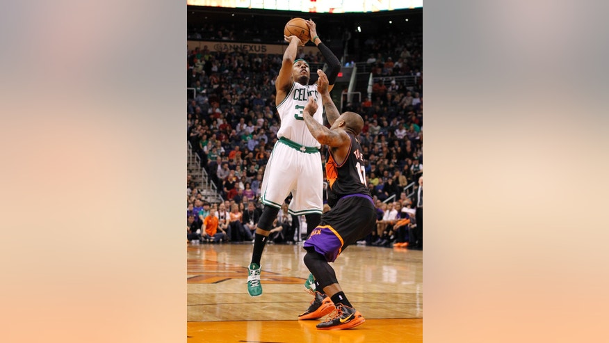 Boston Celtics forward Chris Wlcox, right, drives around Phoenix Suns guard Goran Dragic, left, of Slovenia, in the first half of an NBA basketball game, Friday, Feb. 22, 2013, in Phoenix. (AP Photo/Paul Connors)
