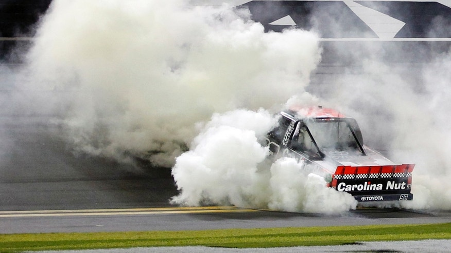Johnny Sauter does a burnout after winning the NASCAR Truck Series auto race at Daytona International Speedway, Friday, Feb. 22, 2013, in Daytona Beach, Fla. (AP Photo/Terry Renna)