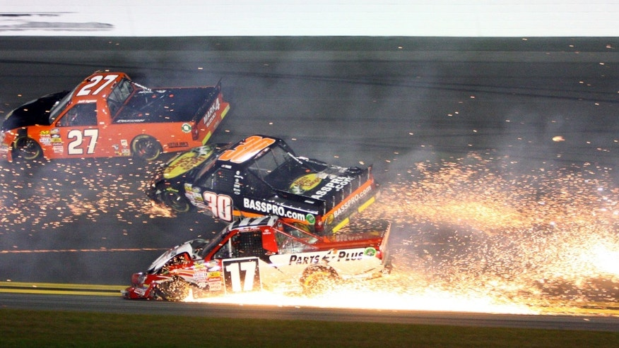 Timothy Peters (17) collides Ryan Truex (30) as Jeff Agnew (27) gets by during the NASCAR Truck Series auto race Friday, Feb. 22, 2013, at Daytona International Speedway in Daytona Beach, Fla. (AP Photo/Ron Sanders)
