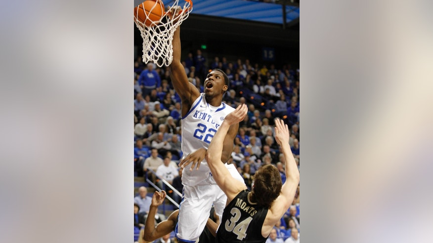 Kentucky's Alex Poythress (22) dunks over Vanderbilt's Shelby Moats (34) during the second half of an NCAA college basketball game at Rupp Arena in Lexington, Ky., Wednesday, Feb. 20, 2013. Kentucky defeated Vanderbilt 74-70. (AP Photo/James Crisp)