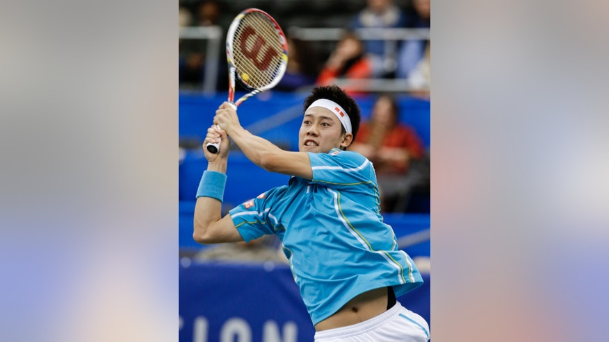 Kei Nishikori, of Japan, returns a shot to Marin Cilic, of Croatia, during a quarterfinal round tennis match at the U.S. National Indoor Championships on Friday, Feb. 22, 2013, in Memphis, Tenn. Nishikori won 6-4, 6-2. (AP Photo/Mark Humphrey)