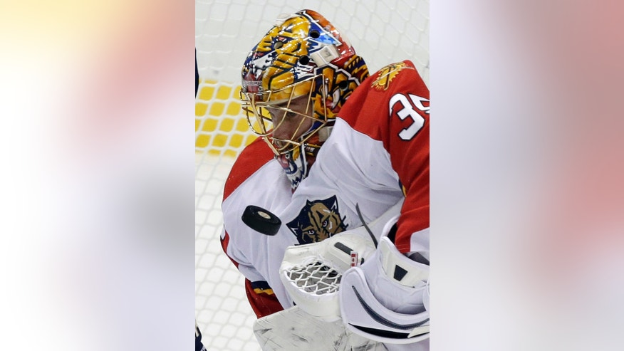 Florida Panthers goalie Jacob Markstrom blocks a shot in the first period of an NHL hockey game against the Pittsburgh Penguins in Pittsburgh on Friday, Feb. 22, 2013. (AP Photo/Gene J. Puskar)
