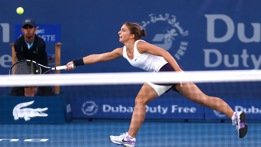 Sara Errani of Italy returns to Roberta Vinci of Italy during the semifinals of the Dubai Duty Free Tennis Championships in Dubai, United Arab Emirates, Friday, Feb. 22, 2013. (AP Photo/Regi Varghese)