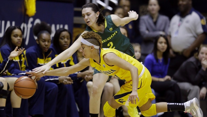 California guard Layshia Clarendon (23) reaches for the ball under Oregon forward Danielle Love (2) during the first half of an NCAA college basketball game in Berkeley, Calif., Friday, Feb. 22, 2013. (AP Photo/Jeff Chiu)