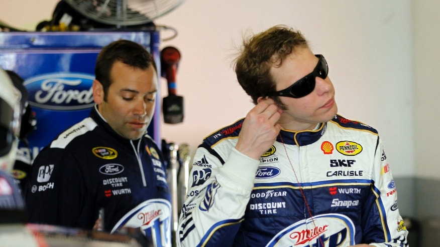 DRIVER Brad Keselowski puts his ear plugs in during a practice session for the NASCAR Sprint Cup Series Daytona 500 auto race Friday, Feb. 22, 2013, at the Daytona International Speedway in Daytona Beach, Fla. (AP Photo/Terry Renna)
