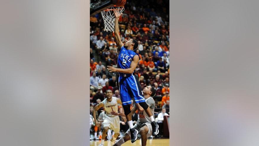 Duke's Quinn Cook (2) shoots over Virginia Tech's Erick Green (11) during the first half of an NCAA college basketball game, Thursday, Feb. 21, 2013, in Blacksburg, Va. (AP Photo/Don Petersen)
