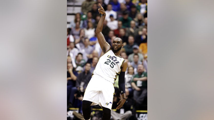 FILE - In this Feb. 12, 2013, file photo, Utah Jazz center Al Jefferson (25) gestures after shooting in the third quarter of an NBA basketball game against the Oklahoma City Thunder in Salt Lake City. The trade deadline passed Thursday, Feb. 21, without the Jazz dealing either Jefferson or forward Paul Millsap, leaving intact a team that is seven games above .500 entering the stretch run toward the playoffs. (AP Photo/Rick Bowmer, File)