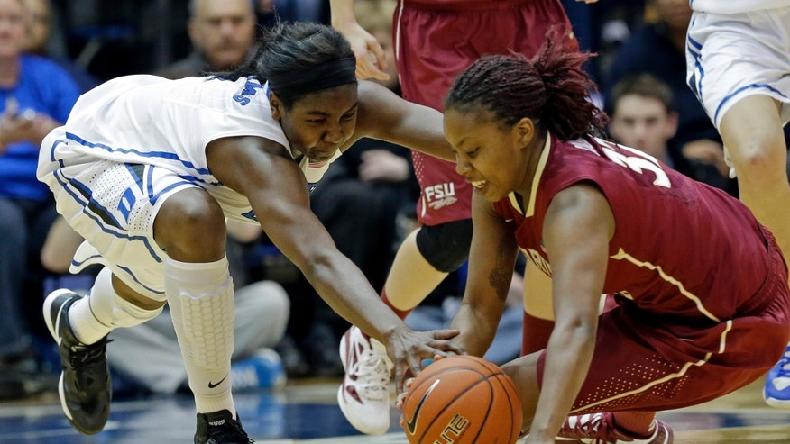 Duke's Elizabeth Williams, left, and Florida State's Lauren Coleman reach for the loose ball during the first half of an NCAA women's college basketball game in Durham, N.C., Friday, Feb. 22, 2013. (AP Photo/Gerry Broome)