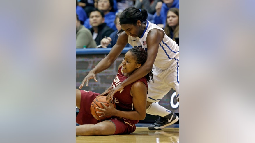 Duke's Elizabeth Williams reaches over Florida State's Lauren Coleman during the second half of an NCAA college basketball game in Durham, N.C., Friday, Feb. 22, 2013. Duke won 61-50. (AP Photo/Gerry Broome)