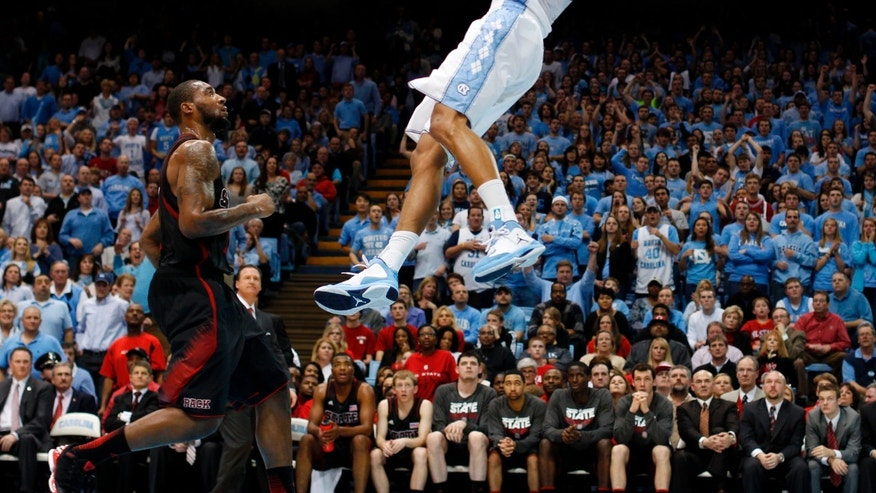 North Carolina's James Michael McAdoo (43) does a reverse dunk as he gets past North Carolina State's Richard Howell (1) on a fast break in the first half of an NCAA college basketball game Saturday, Feb. 23, 2013, at the Smith Center in Chapel Hill, N.C. (AP Photo/The News & Observer, Robert Willett) MANDATORY CREDIT
