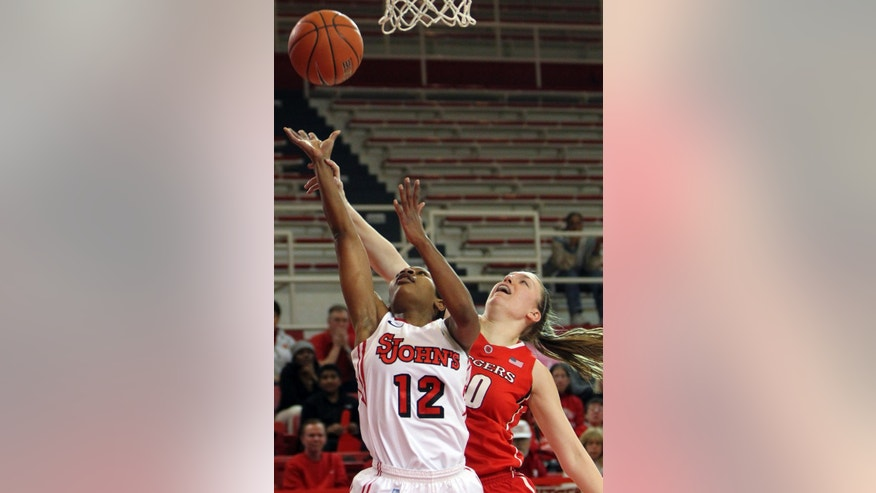 St. John's Briana Brown (12) goes up for a basket past Rutgers' Christa Evans during the first half of an NCAA women's college basketball game, Saturday, Feb. 23, 2013, in New York. (AP Photo/Mary Altaffer)