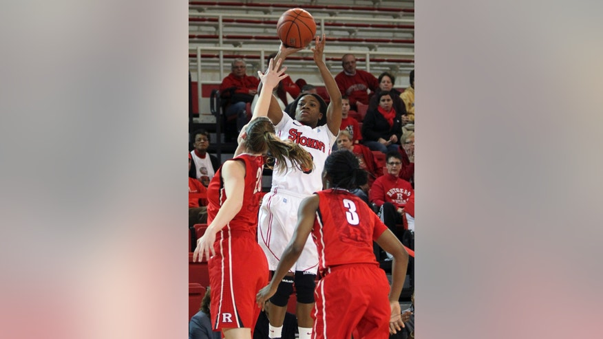 St. John's Aliyyah Handford, center, goes up past Rutgers' Christa Evans, left, and Erica Wheeler, during the first half in an NCAA women's college basketball game, Saturday, Feb. 23, 2013, in New York. (AP Photo/Mary Altaffer)