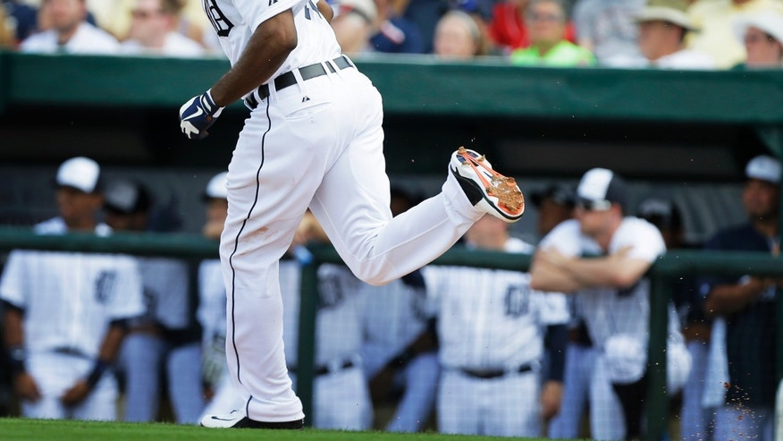 Detroit Tigers right fielder Torii Hunter runs to first base after hitting a ground ball during the fourth inning of an exhibition spring training baseball game against the Toronto Blue Jays, Saturday, Feb. 23, 2013, in Lakeland, Fla.  Hunter was out on the play. (AP Photo/Charlie Neibergall)