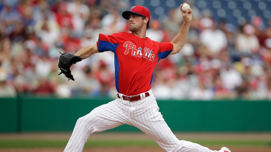 Philadelphia Phillies' Cole Hamels pitches during the first inning of an exhibition spring training baseball game against the Houston Astros, Saturday, Feb. 23, 2013, in Clearwater, in Fla. (AP Photo/Matt Slocum)
