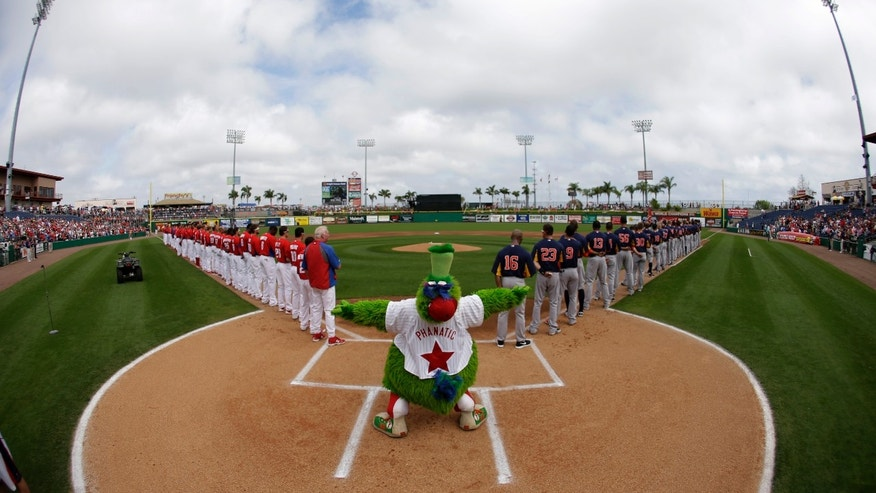 In this image taken with a fisheye lens, the Philadelphia Phillies' mascot, the Phillie Phanatic, reacts after the playing of the national anthem before the start of an exhibition spring training baseball game between the Phillies and the Houston Astros, Saturday, Feb. 23, 2013, in Clearwater, in Fla. (AP Photo/Matt Slocum)