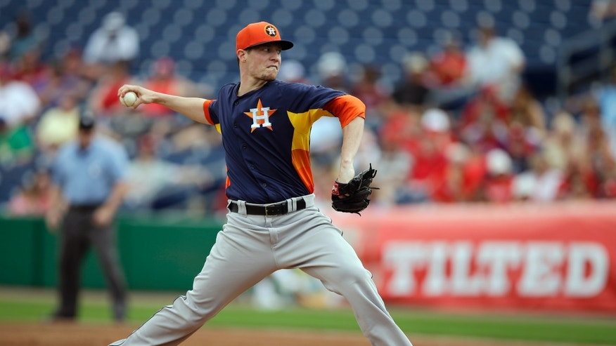 Houston Astros' Lucas Harrell pitches during the first inning of an exhibition spring training baseball game against the Philadelphia Phillies, Saturday, Feb. 23, 2013, in Clearwater, in Fla. (AP Photo/Matt Slocum)