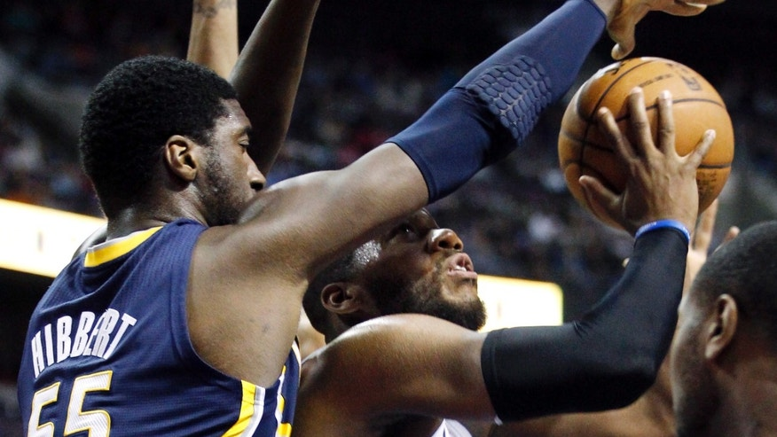Indiana Pacers center Roy Hibbert (55) defends Detroit Pistons center Greg Monroe (10) during the first half of an NBA basketball game Saturday, Feb. 23, 2013, in Auburn Hills, Mich. The Pacers defeated the Pistons 90-72. (AP Photo/Duane Burleson)
