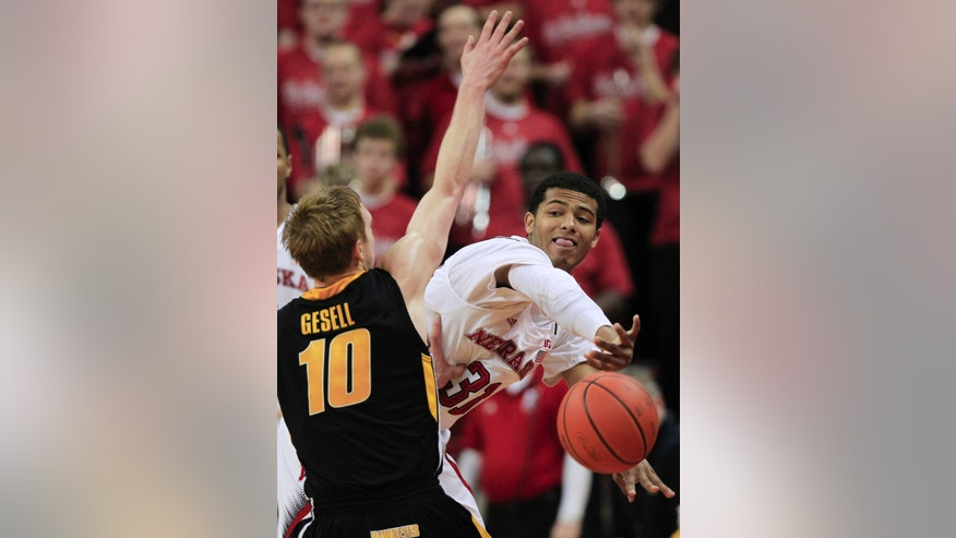 Nebraska's Shavon Shields, right, tries to pass the ball against Iowa's Mike Gesell (10) in the first half of an NCAA college basketball game in Lincoln, Neb., Saturday, Feb. 23, 2013. (AP Photo/Nati Harnik)
