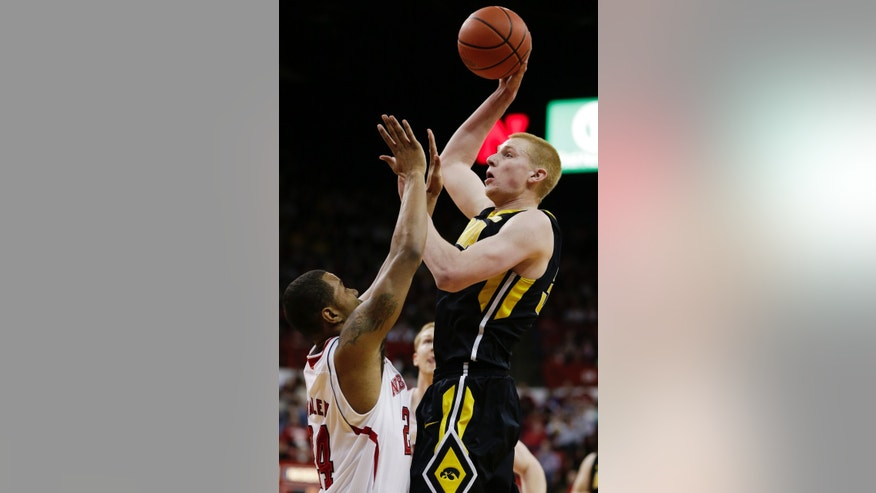 Iowa's Aaron White, right, shoots over Nebraska's Dylan Talley in the first half of an NCAA college basketball game in Lincoln, Neb., Saturday, Feb. 23, 2013. (AP Photo/Nati Harnik)